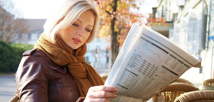woman-with-newspaper-feat