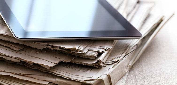 newspaper-stack-tablet-shutterstock-feat
