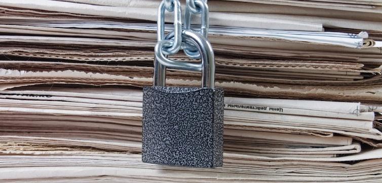 locked-newspaper-censorship-shutterstock-feat
