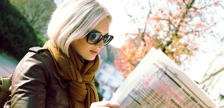 woman-reading-newspaper-shutterstock-feat