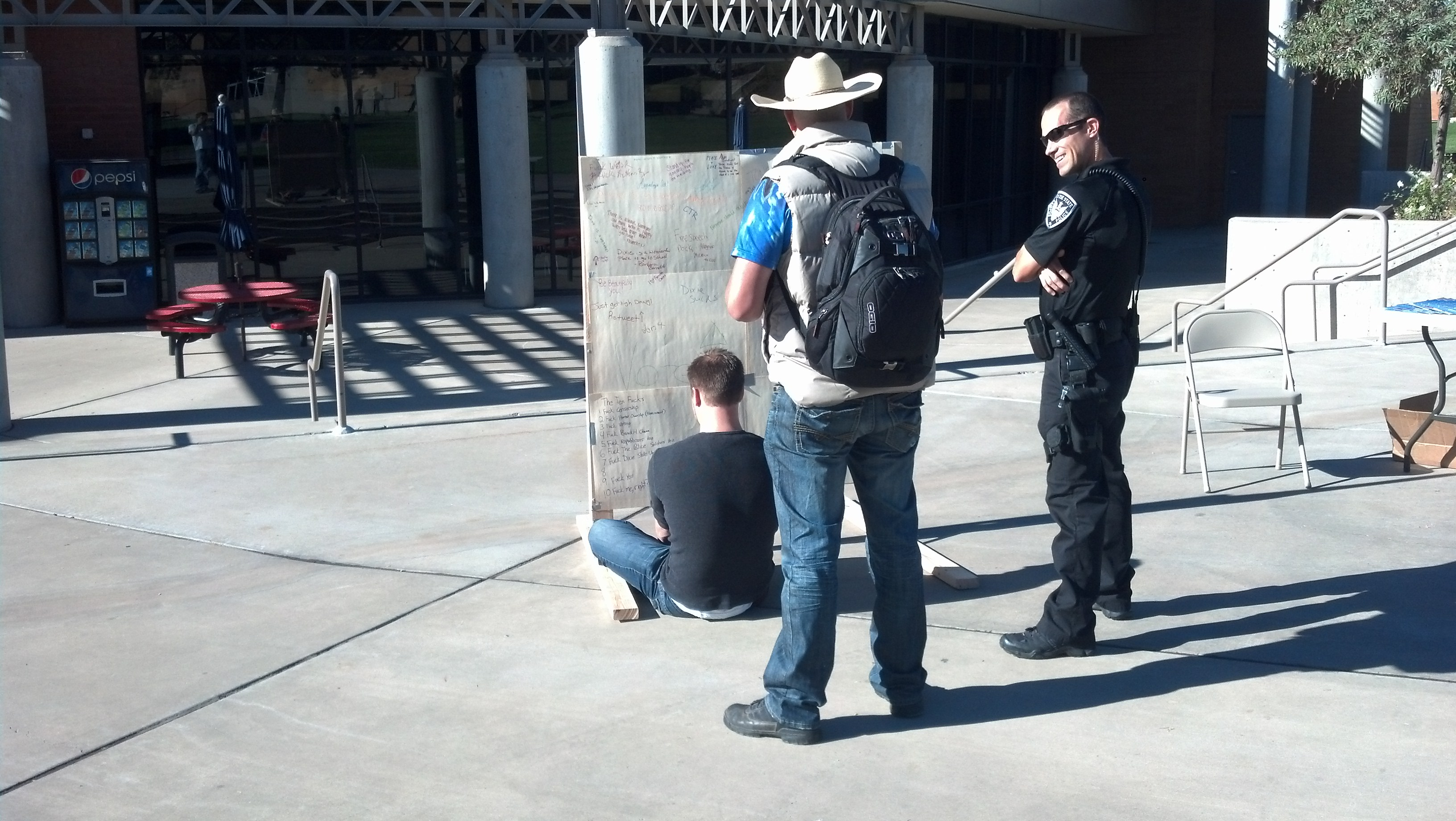 Officer at Dixie State University Free Speech Wall
