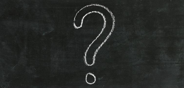 large question mark in chalk on a blackboard