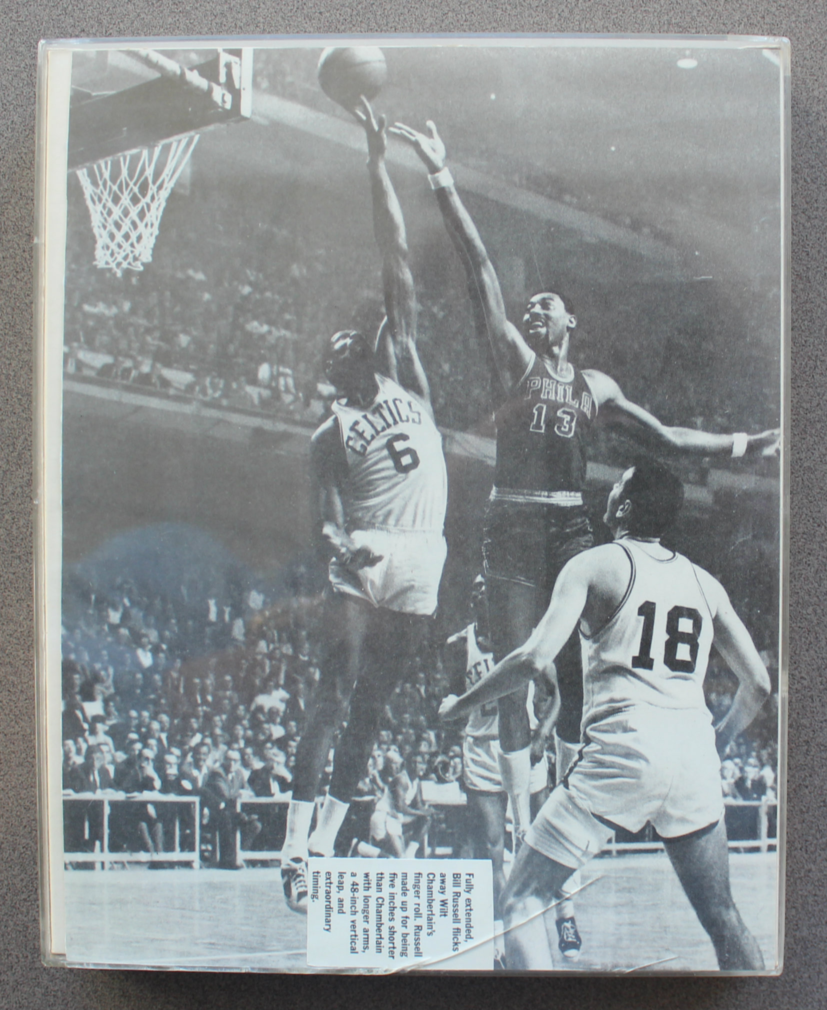 Bill Russell blocks a Wilt Chamberlain shot.