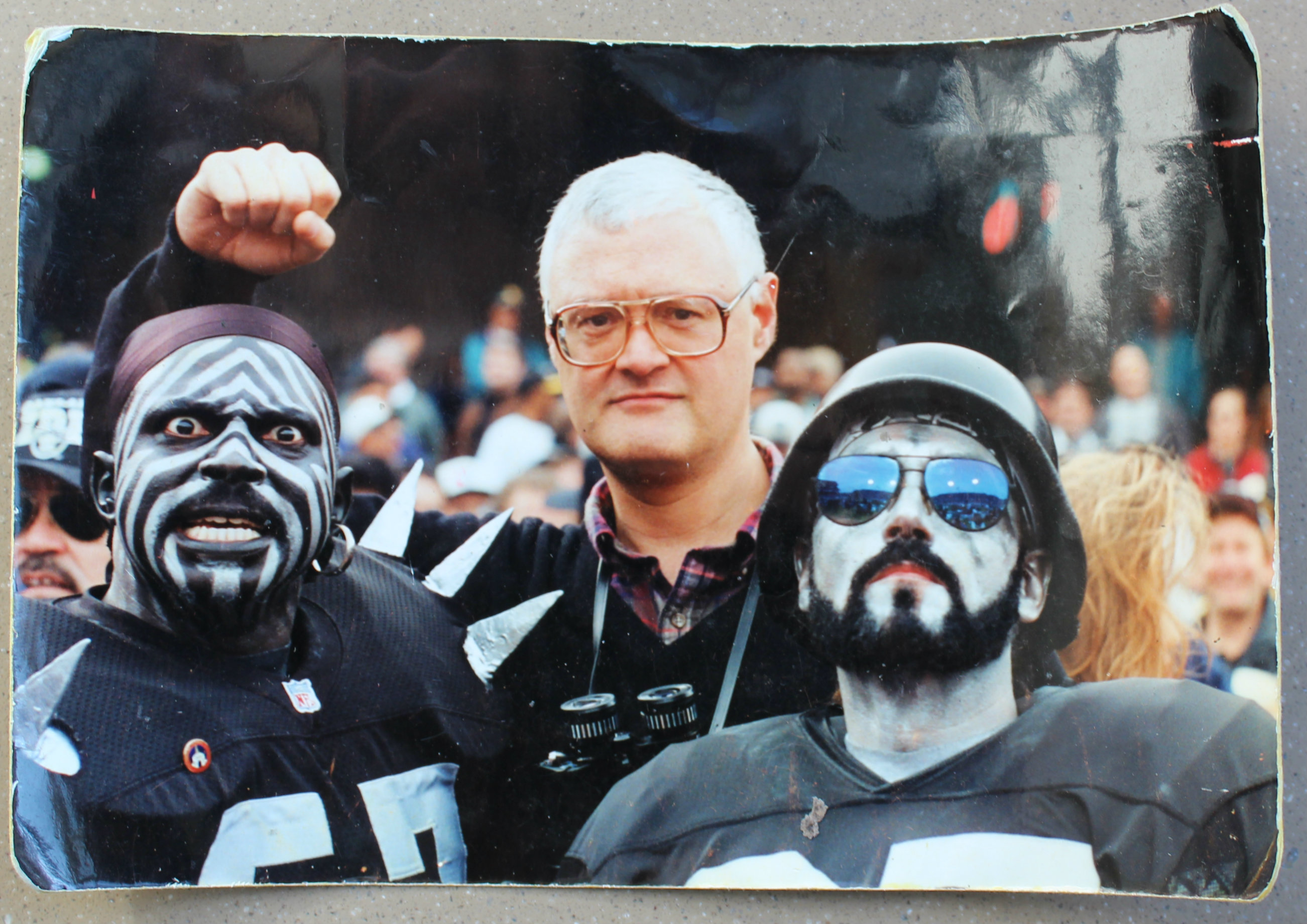 Downs (center) with Oakland Raiders fans.