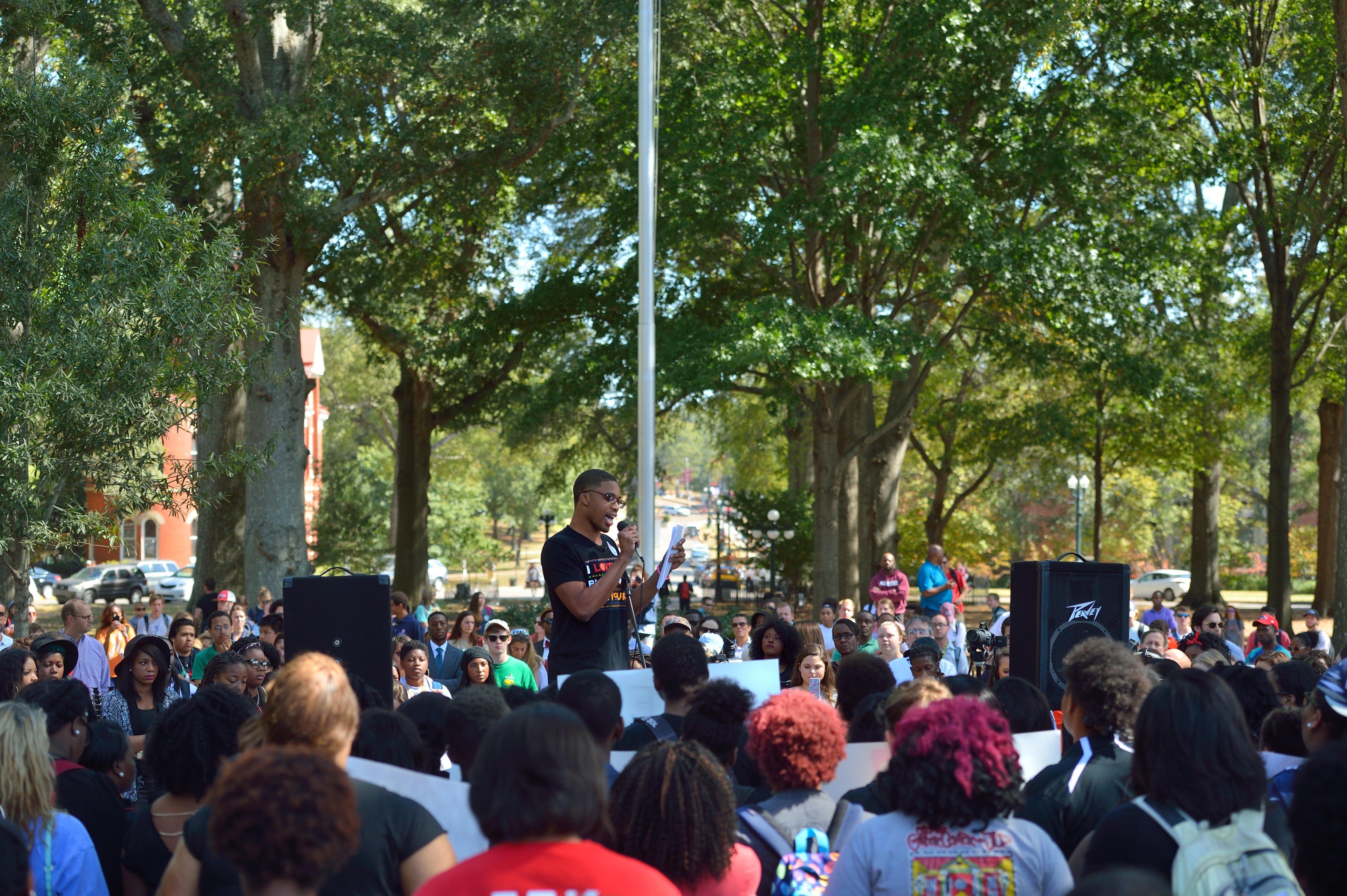 Buka Okoye, president of the campus NAACP, reads from a prepared statement at the rally in the circle asking that the ASB request the administration cease displaying the Mississippi state flag because of the confederate symbol it contains. Photo by Kevin Bain/Ole Miss Communications