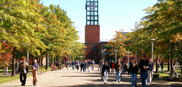 EVANGELOS DOUSMANIS/BINGHAMTON UNIVERSITY Students walk by the Clock Tower at University Union in the fall at Binghamton University, October 02, 2002.