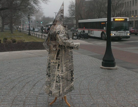 Serhat Tanyolacar created a Ku Klux Klan hood and robe covered in a collage of newspaper images of racial violence.
