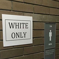 "In 2015, University at Buffalo student Ashley Powell posted ""White Only"" and ""Black Only"" signs outside water fountains and bathrooms on campus."