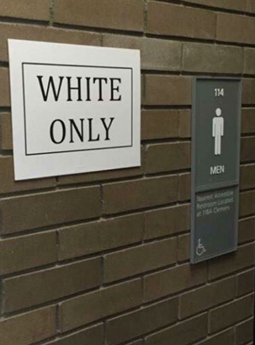 "A student's ""black only"" and ""white only"" posters, which were intended to draw attention to racism, were removed by campus police and investigated."