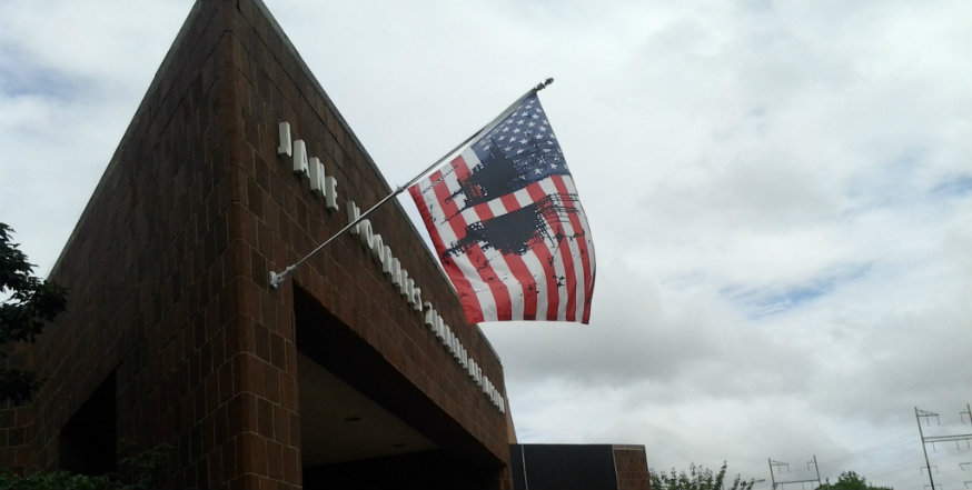 Rutgers restores flag artwork display after temporarily moving it indoors