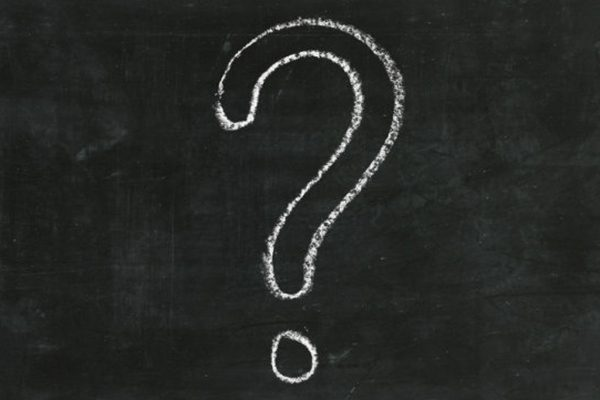 large question mark in chalk on a blackboard