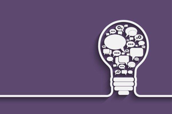 speech bubbles inside of an idea lightbulb