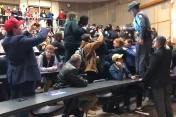 Protestors interrupt Art Laffer during his speech at Binghamton University.