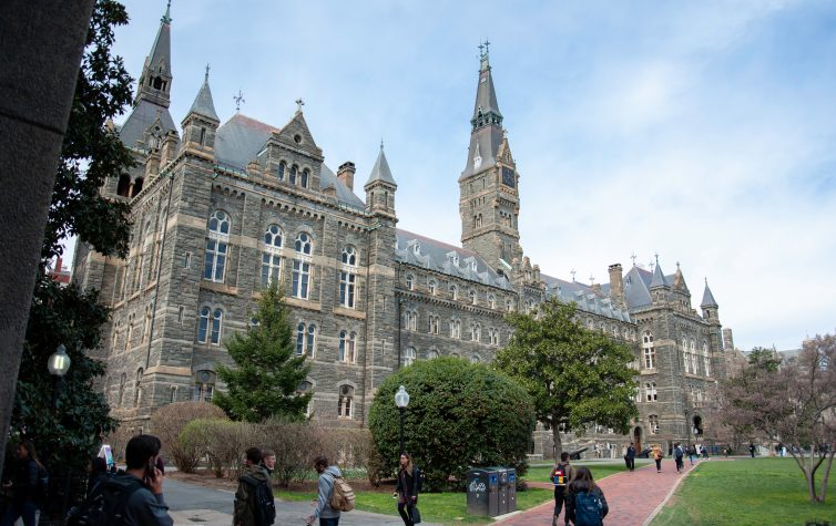 Students walk near Healy Hall at Georgetown University.