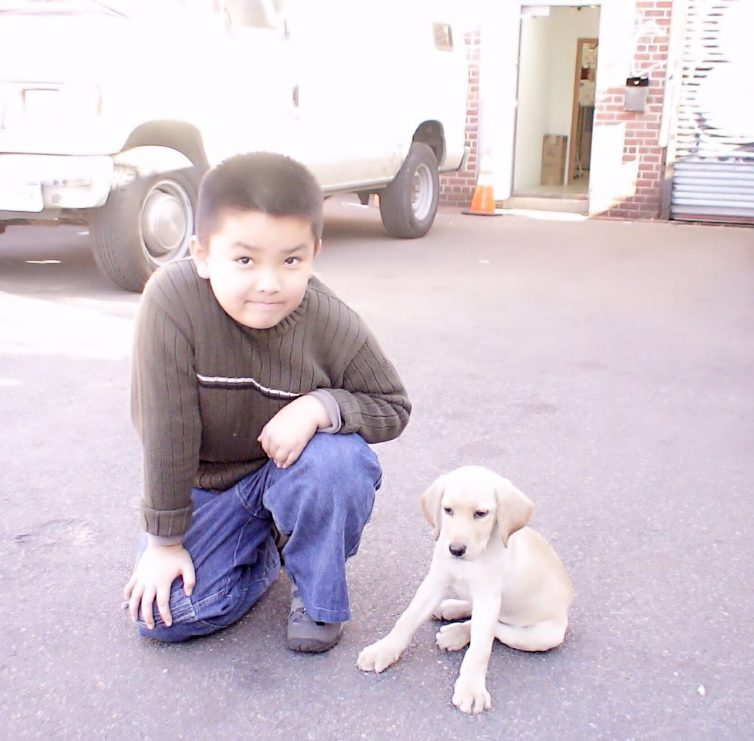 Austin Tong as a boy in New York City, with his puppy.