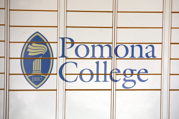 A sign with Pomona College's logo on campus.