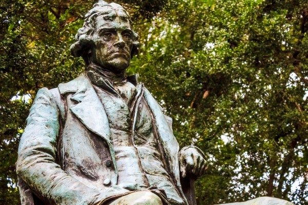 UVA campus statue of Thomas Jefferson, visibly displeased that the university he founded is ignoring the First Amendment he helped shape.
