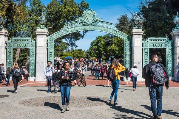 Students pass through UC Berkeley entrance gate