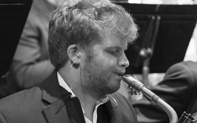 Tim Hecker black and white playing saxophone