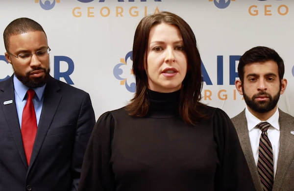 Abby Martin (center) delivers remarks on her lawsuit against Georgia Southern University. This week, a federal court found Georgia Southern violated Martin's rights when it withdrew a speaking invitation because of her pro-Palestine views. (Empire Files / YouTube.com)