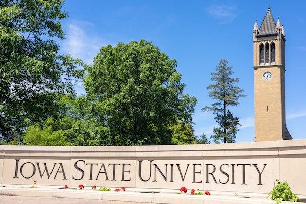 View of Iowa State University sign and campanile (central landmark) with green environment and blue sky. Popular collage of Engineering, Business, Management. Editorial