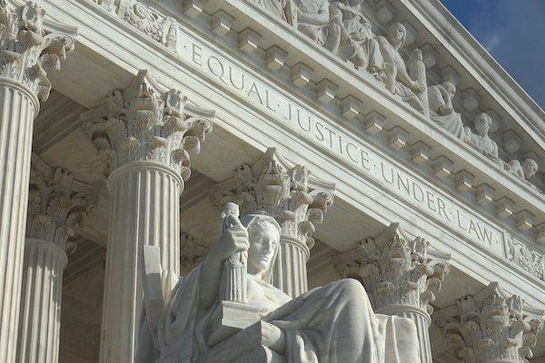 Equal Justice Under Law engraving above entrance to US Supreme Court Building.